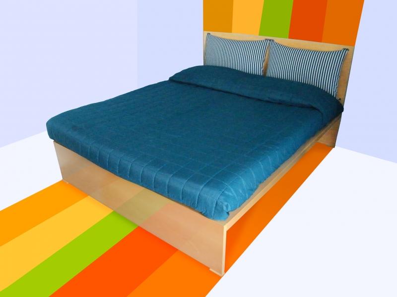 Letto Alessandro: foto del letto su sfondo arcobaleno.